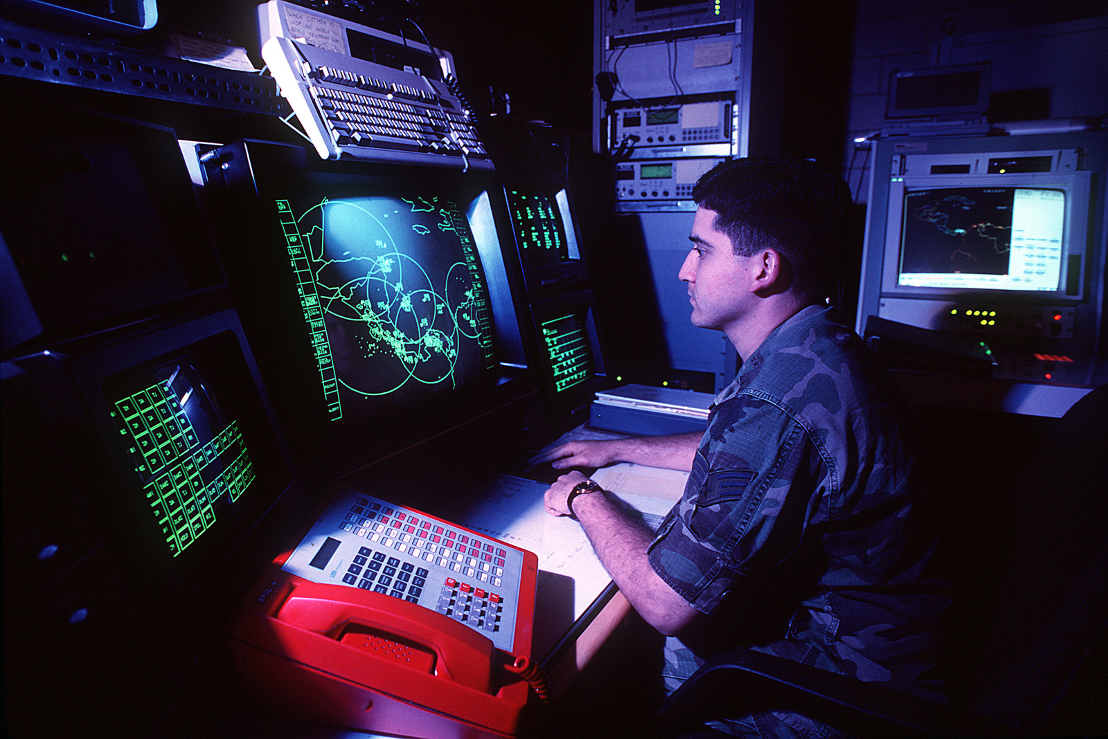 A surveillance operator at the Southern Regional Operations Center spends a  shift at a radar scope