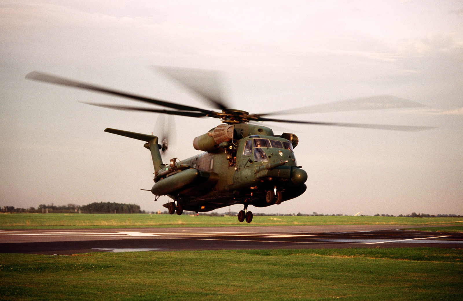 A U.S. Air Force MH-53 departs for a mission. The MH-53's were used to move troops throughout the exercise area.(Exact date unknown)
