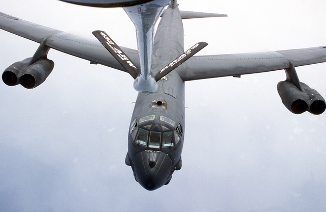 Aerial view as USAF B-52 Stratofortress long-range bomber moves into position for aerial refueling by a KC-135 tanker from the 452nd Air Refueling Wing, March Air Force Base, California. Exact Date Shot Unknown