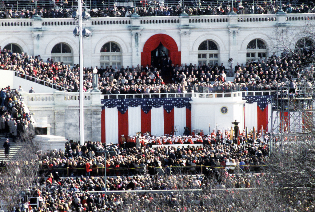 Armed Forces Inaugural Committee behind the scenes. Crowds stand near the capitol during the swearing-in ceremony