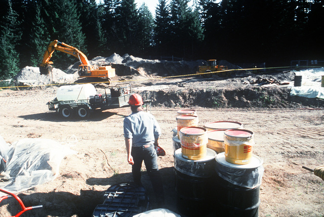 Cleanup efforts take place at a site used for disposal of pesticide containers several decades ago