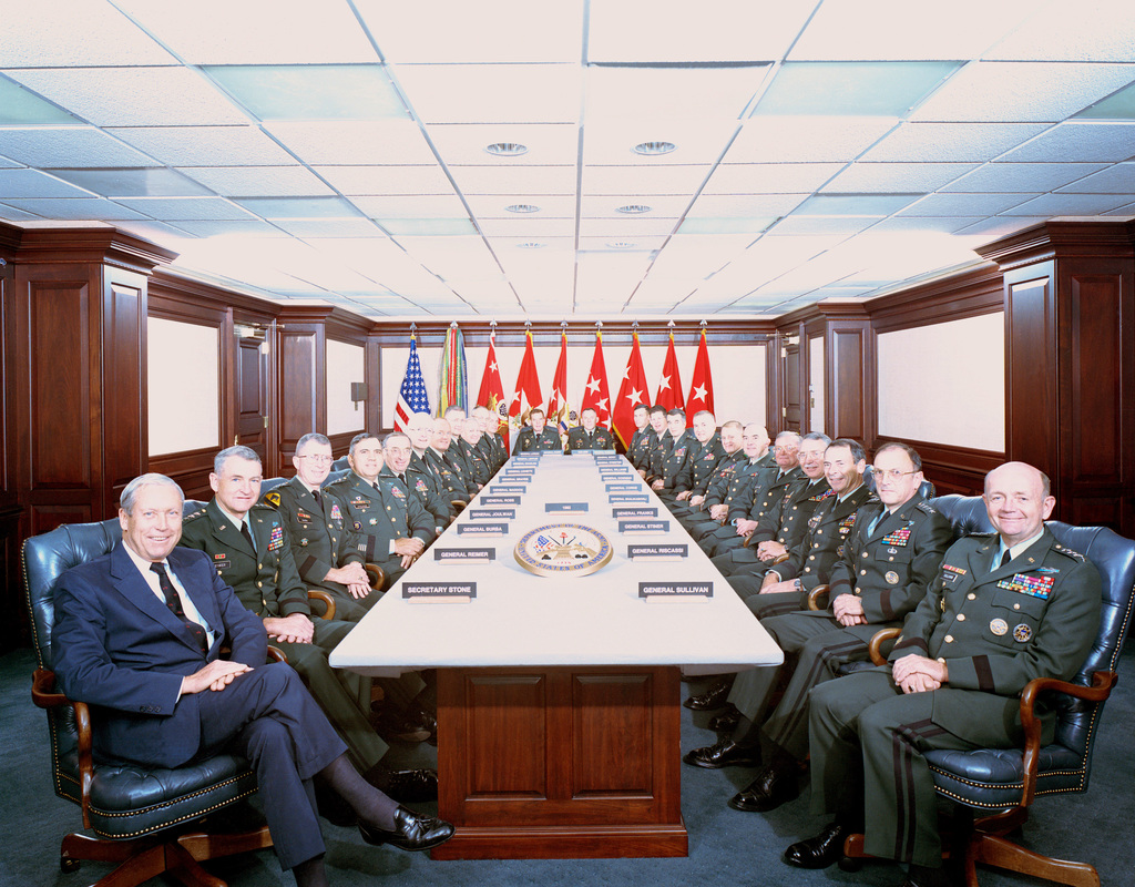 Group photograph of the 1993 Commander's Conference with GEN Gordon R. Sullivan (left), Army CHIEF of STAFF. Clockwise from lower left: GEN Sullivan, GEN Dennis J. Reimer, Commander, Forces Command, GEN Jimmy D. Ross, Commander, Army Material Command, LGEN Wayne A. Downing, Commander in CHIEF, U.S. Readiness/U.S. Special Operations Command, LGEN Howard D. Graves, Commander, Military Academy, West Point, LGEN Arthur E. Williams, CHIEF of Engineers, MGEN Richard D. Cameron, Commander, Health Services Command, LGEN Roger K. Bean (unit unknown), MGEN Paul E. Menoher, Jr., Commander, Army Intelligence and Security Command, MGEN Richard G. Larson, Commander, Military Traffic Management Command...