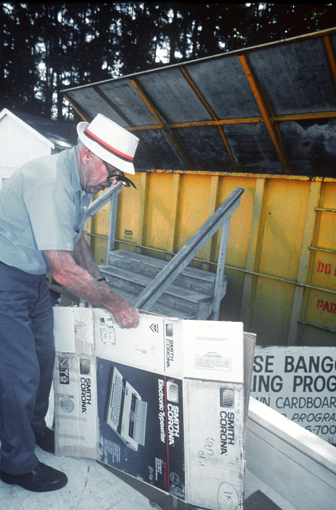 Loring Lam, a retired Navy officer, returns cardboard to a recycling center
