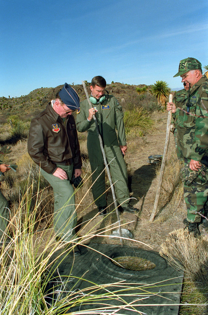 LT. GEN. Martin Ryan, left, 8th Air Force commander, COL. Doug Mang, 28th Bomb Wing commander, and LT. COL. Clinton Woods, 96th Civil Engineering Squadron commander, examine one of the largest places of wreckage from the crash site of a B-1B bomber aircraft from Dyess Air Force Base. EXACT DATE SHOT UNKNOWN
