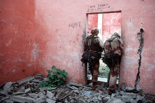Marines of Task Force Mogadishu enter a building to search for weapons during the multinational relief effort Operation Restore Hope