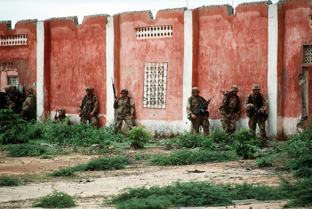 Marines of Task Force Somalia prepare to search a building for weapons during the multinational relief effort Operation Restore Hope