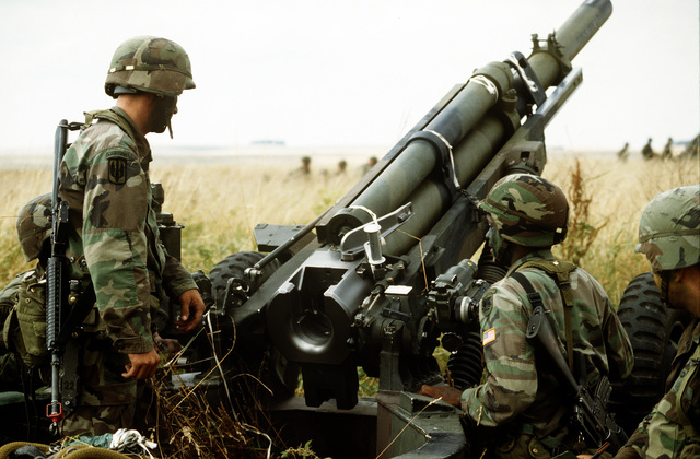 Soldiers from the 3rd Battalion 325th Infantry Regiment set up an 105mm howitzer M102 while participating in the exercise Roaring Lion.(Exact date unknown)