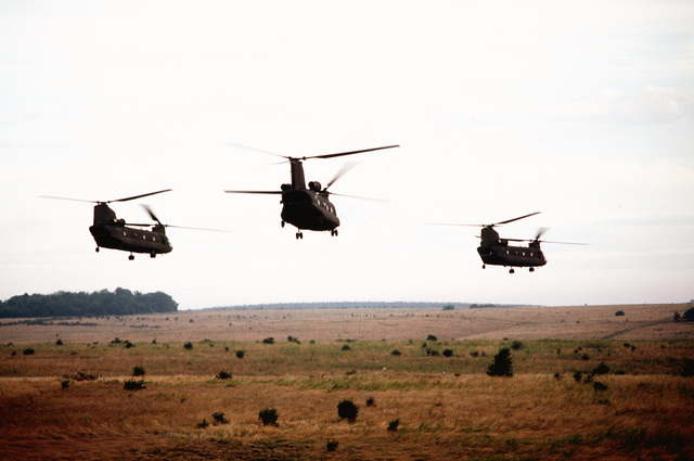 U.S. Army CH-47s take off from a field during the exercise. The helicopters have picked up troops to move to another part of the exercise area.(Exact date unknown)