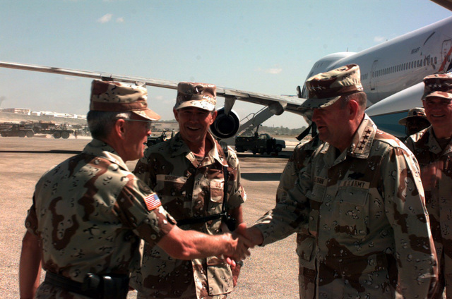 GEN. Gordon R. Sullivan, Army CHIEF of STAFF, shakes hands with MAJ. GEN. Stephen Arnold, Commander, 10th Mountain Division (Light Infantry), FT Drum, NY, after arriving at the airport