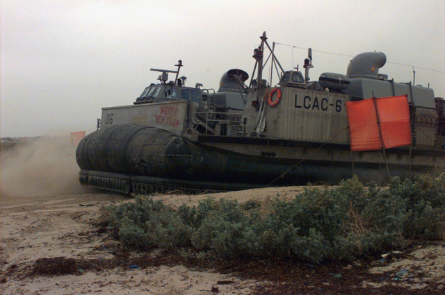Air Cushioned Landing Craft (LCAC) 06 crosses the beach to return US Marines and their equipment to the USS MOUNT RUSHMORE offshore. The LCAC, Marines and the USS MOUNT RUSHMORE are all part of Joint Task Force Somalia