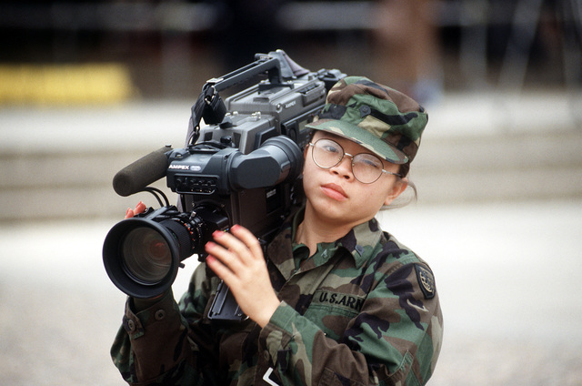 U. S. Army SPC Leight Ha, A videographer augmented to the Armed Forces Inaugural Committee (AFIC), J-6 division, prepares to document an AFIC related activity during the 1993 Inaugural