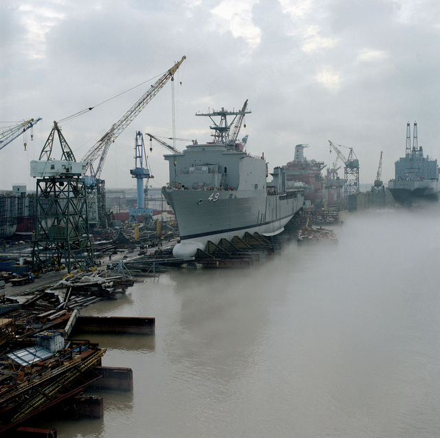 A port bow view of the dock landing ship HARPERS FERRY (LSD-49) on the waysat Avondale Shipyards prior to its christening and launching ceremony