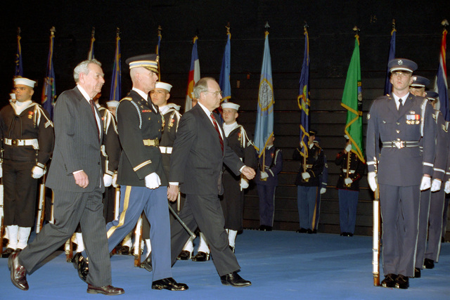 The Honorable (Richard Bruce) Dick Cheney (front, third from left), U.S. Secretary of Defense, and the Honorable Donald J. Atwood (front, left), Deputy U.S. Secretary of Defense, review U.S. Military Honor Guard units during their combined farewell ceremony in Ceremonial Hall, Ft. Myer, Va., on Jan. 12, 1993.  OSD Package No. A07D-00088 (DOD PHOTO by Helene C. Stikkel) (Released)