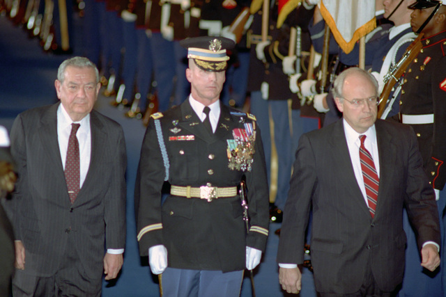 The Honorable (Richard Bruce) Dick Cheney (right), U.S. Secretary of Defense, and the Honorable Donald J. Atwood (left), Deputy U.S. Secretary of Defense, review U.S. Military Honor Guard units during their combined farewell ceremony in Ceremonial Hall, Ft. Myer, Va., on Jan. 12, 1993.  OSD Package No. A07D-00088 (DOD PHOTO by Helene C. Stikkel) (Released)