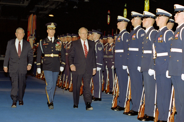 The Honorable (Richard Bruce) Dick Cheney (third from left), U.S. Secretary of Defense, and the Honorable Donald J. Atwood (left), Deputy U.S. Secretary of Defense, review U.S. Military Honor Guard units during their combined farewell ceremony in Ceremonial Hall, Ft. Myer, Va., on Jan. 12, 1993.  OSD Package No. A07D-00088 (DOD PHOTO by Helene C. Stikkel) (Released)