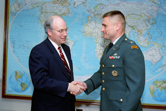 The Honorable (Richard Bruce) Dick Cheney (left), U.S. Secretary of Defense, poses for an official photograph with a U.S. Army Captain, serving as an intern in the Office of the Secretary of Defense, on Jan. 13, 1993.  OSD Package No. A07D-00091 (DOD PHOTO by Robert D. Ward) (Released)