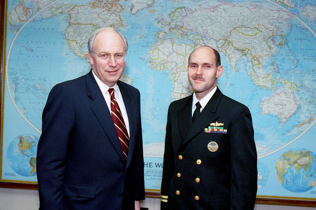 The Honorable (Richard Bruce) Dick Cheney (left), U.S. Secretary of Defense, poses for an official photograph with a U.S. Navy Lieutenant (right), serving as an intern in the Office of the Secretary of Defense, on Jan. 13, 1993.  OSD Package No. A07D-00091 (DOD PHOTO by Robert D. Ward) (Released)
