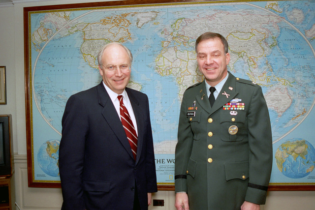 The Honorable (Richard Bruce) Dick Cheney (left), U.S. Secretary of Defense, poses for an official photograph with a U.S. Army Colonel, serving as an intern in the Office of the Secretary of Defense, on Jan. 13, 1993.  OSD Package No. A07D-00091 (DOD PHOTO by Robert D. Ward) (Released)