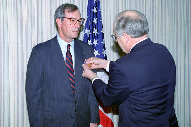 The Honorable (Richard Bruce) Dick Cheney (right), U.S. Secretary of Defense, presents the Defense Public Service Medal to the Honorable Dr. Donald B. Rice (left), Secretary of the Air Force, for services rendered at a ceremony in the Pentagon on Jan. 13, 1993.  OSD Package No. A07D-00093 (DOD PHOTO by Robert D. Ward) (Released)