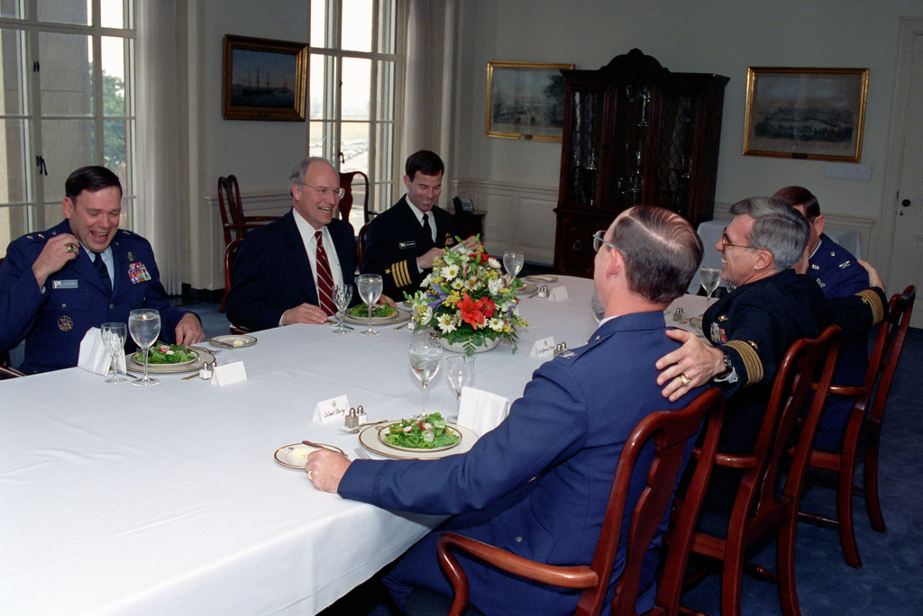 The Honorable (Richard Bruce) Dick Cheney (second from left), U.S. Secretary of Defense, has lunch with U.S. Air Force MAJ. GEN. John P. Jumper (left), SENIOR Assistant to the Secretary of Defense; U.S. Navy Vice Admiral William A. Owens (second from right), Deputy CHIEF of Naval Operations for Resources, Warfare Requirements and assessment (N8); a U.S. Navy Captain (third from left); and two U.S. Air Force Colonels (third from right and right), in the Pentagon on Jan. 13, 1993.  OSD Package No. A07D-00092 (DOD PHOTO by Robert D. Ward) (Released)