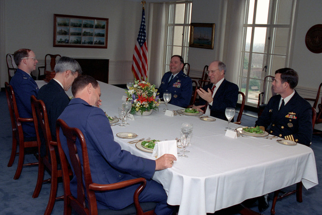 The Honorable (Richard Bruce) Dick Cheney (second from right), U.S. Secretary of Defense, has lunch with U.S. Air Force MAJ. GEN. John P. Jumper (third from right), SENIOR Assistant to the Secretary of Defense; U.S. Navy Vice Admiral William A. Owens (second from left), Deputy CHIEF of Naval Operations for Resources, Warfare Requirements and assessment (N8); a U.S. Navy Captain (right); and two U.S. Air Force Colonels (left third from left), in the Pentagon on Jan. 13, 1993.  OSD Package No. A07D-00092 (DOD PHOTO by Robert D. Ward) (Released)
