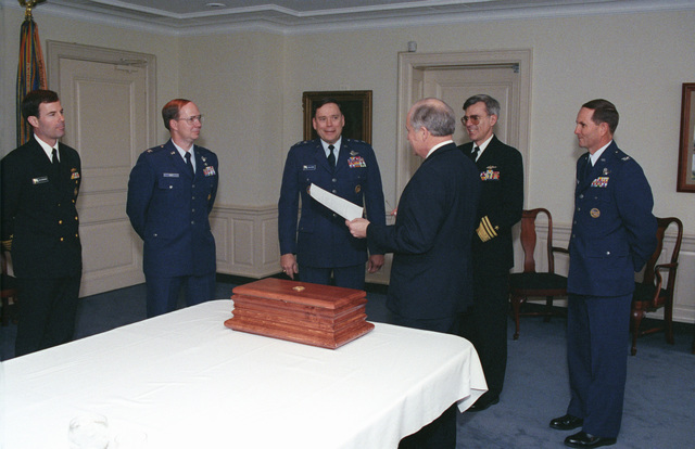 The Honorable (Richard Bruce) Dick Cheney (third from right), U.S. Secretary of Defense, meets with U.S. Air Force MAJ. GEN. John P. Jumper (third from left), SENIOR Assistant to the Secretary of Defense; U.S. Navy Vice Admiral William A. Owens (second from right), Deputy CHIEF of Naval Operations for Resources, Warfare Requirements and assessment (N8); a U.S. Navy Captain (left); and two U.S. Air Force Colonels (second from left and right), prior to having lunch with them in the Pentagon on Jan. 13, 1993.  OSD Package No. A07D-00092 (DOD PHOTO by Robert D. Ward) (Released)
