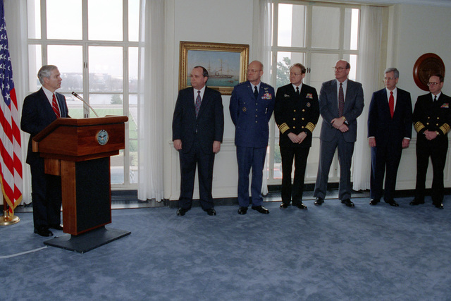 Director of the Central Intelligence Agency, Mr. Thomas Gates (left), presents awards to six DOD Intelligence Experts on Jan. 14, 1993 at the Pentagon in Washington, D.C.  OSD Package No. A07D-00096 (DOD PHOTO by Robert D. Ward) (Released)