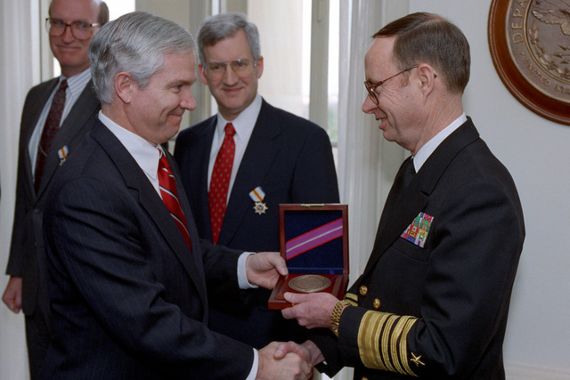 Director of the Central Intelligence Agency, Mr. Thomas Gates, presents awards to six DOD Intelligence Experts on Jan. 14, 1993 at the Pentagon in Washington, D.C.  OSD Package No. A07D-00096 (DOD PHOTO by Robert D. Ward) (Released)