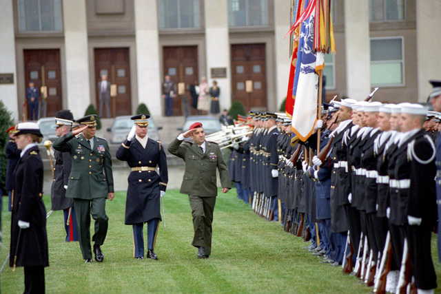 U.S. Army GEN. Colin Powell (left), Chairman of the Joint Chiefs of STAFF, and CHIEF of the General STAFF, Israeli Defense Forces, LT. GEN. Ehud Barak (right), are accompanied by the Commander of Troops as they review the troops during a Joint Service Open House Ceremony at the Pentagon on Jan. 14, 2003.  OSD Package No. A07D-00095 (DOD PHOTO by Robert D.Ward) (Released)