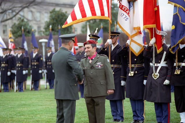 U.S. Army GEN. Colin Powell (left), Chairman of the Joint Chiefs of STAFF, shakes hands and greets CHIEF of the General STAFF, Israeli Defense Forces, LT. GEN. Ehud Barak (right), during an Armed Forces Full Honor Arrival Ceremony at the Pentagon on Jan. 14, 2003.  OSD Package No. A07D-00095 (DOD PHOTO by Robert D.Ward) (Released)