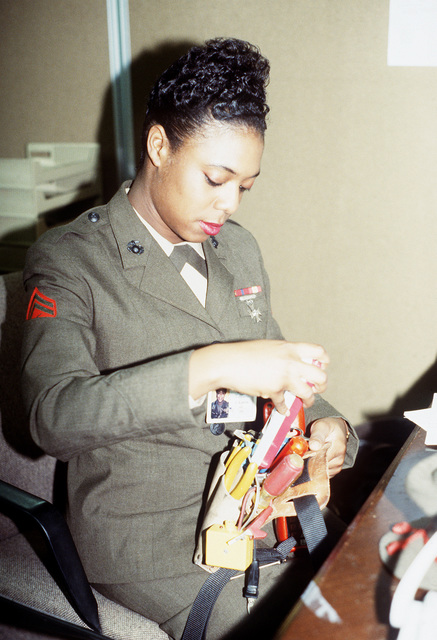 Armed Forces Inaugural Committee behind the scenes. CPL Blanding of the AFIC J-6 directorate prepares to repair telephones within the AFIC in support of the 1993 Inauguration