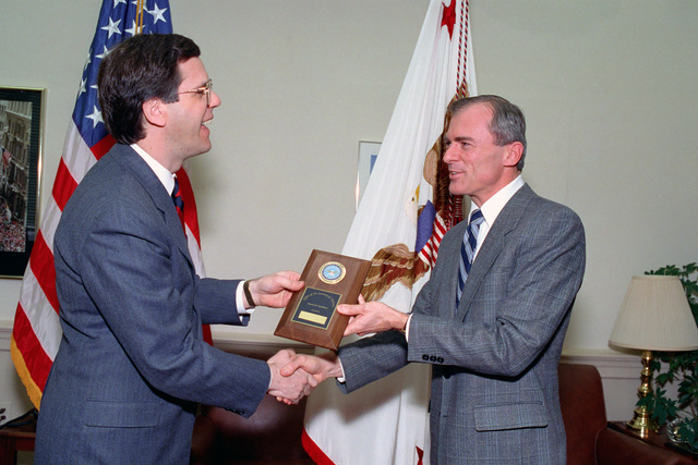 Assistant Secretary of Defense Pete Williams (left), presents an award to Robert D. Ward, in recognition of his outstanding performance and support to the Office of the Assistant Secretary of Defense for Public Affairs, Jan. 15, 1993.  OSD Package No. A07D-00101 (DOD PHOTO by Helene C. Stikkel) (Released)