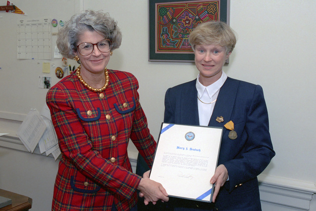 Ms. Donna Larsen (left) presents Ms. Mary S. Deutsch with the certificate for the Secretary of Defense Medal for Meritorious Civilian Service, Jan. 15, 1993.  OSD Package A07D-00104 (DOD PHOTO by Robert D. Ward) (Released)