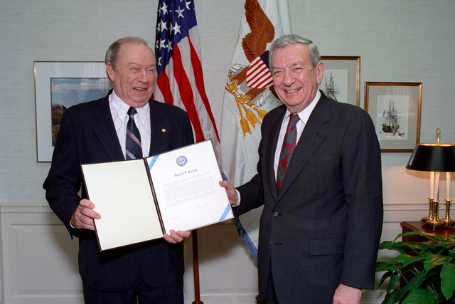 The Honorable Donald Atwood (right), Deputy Secretary of Defense, poses with the Honorable Donald Yockey (left), Under Secretary of Defense for Acquisition and Technology, for an official photograph after awarding him the Distinguished Public Service Medal in a ceremony held in the Pentagon on Jan. 15, 1993.  OSD Package No. A07D-00103 (DOD PHOTO by Helene C. Stikkel) (Released)