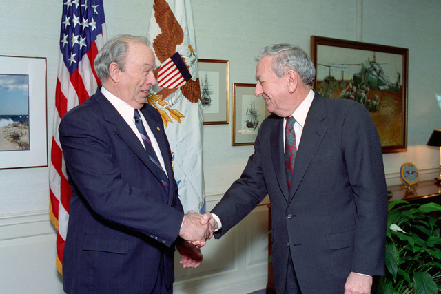 The Honorable Donald Atwood (right), Deputy Secretary of Defense, shakes hands with the Honorable Donald Yockey (left), Under Secretary of Defense for Acquisition and Technology, after awarding him the Distinguished Public Service Medal in a ceremony held in the Pentagon on Jan. 15, 1993.  OSD Package No. A07D-00103 (DOD PHOTO by Helene C. Stikkel) (Released)