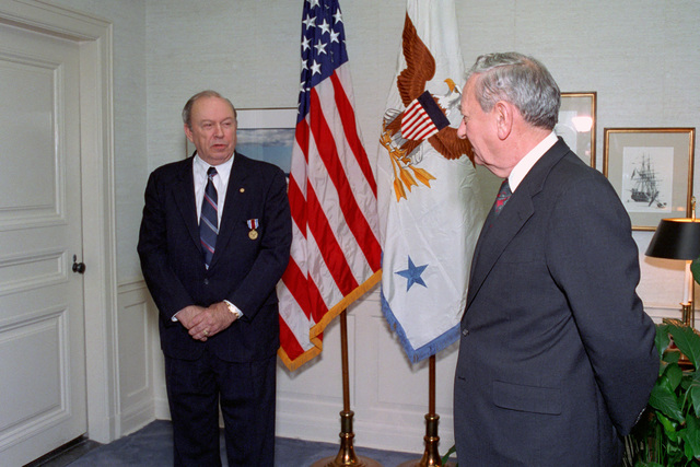 The Honorable Donald Atwood (right), Deputy Secretary of Defense, speaks with the Honorable Donald Yockey (left), Under Secretary of Defense for Acquisition and Technology, after awarding him the Distinguished Public Service Medal in a ceremony held in the Pentagon on Jan. 15, 1993.  OSD Package No. A07D-00103 (DOD PHOTO by Helene C. Stikkel) (Released)