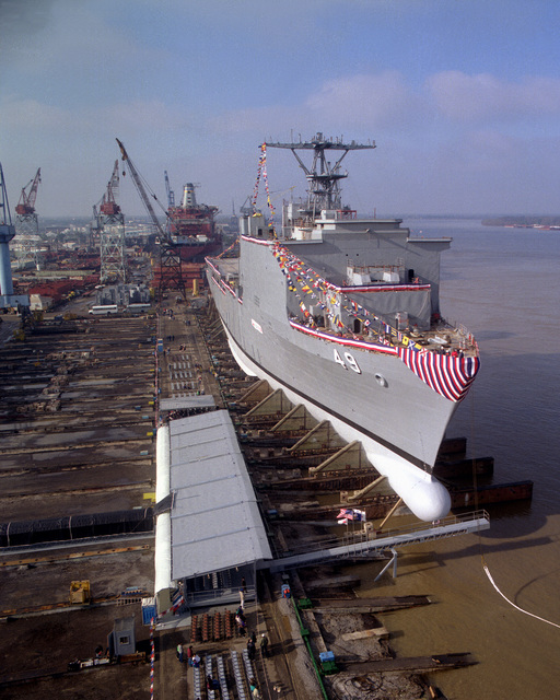 A starboard bow view of the dock landing ship HARPERS FERRY (LSD-49) as it sits on the ways prior to launching during its christening and launching ceremony at Avondale Shipyards