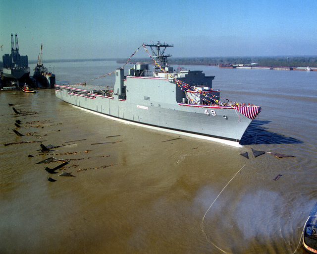 A starboard bow view of the dock landing ship HARPERS FERRY (LSD-49) following its launch from the ways during the christening and launching ceremony at Avondale