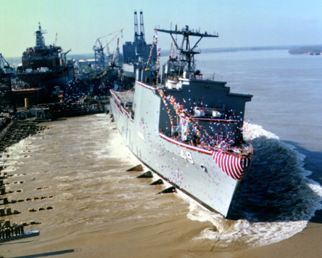 Balloons are released as the dock landing ship HARPERS FERRY (LSD-49) is launched from the ways during its christening and launching ceremony at Avondale Shipyards