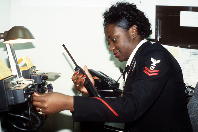 Armed Forces Inaugural Committee behind the scenes. An AFIC augmentee uses the services of the J-6 directorate by operating a radio base station