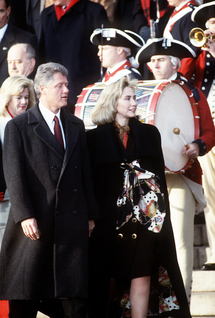 Armed Forces Inaugural Committee behind the scenes. President-elect William Jefferson Clinton and his wife Hillary attends the diplomatic reception at Georgetown University as the colonial guard form a cordon and the fife and drum corps render honors