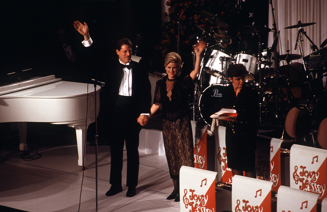 Armed Forces Inaugural Committee behind the scenes. Vic President Al Gore and his wife, Tipper, wave to the guest at the ball in the Pension building the evening of Janaury 20, 1993
