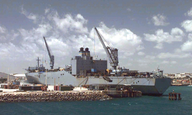 Long shot, left side rear view, of the US Navy Military Sealift Command Ship Capella as it offloads military vehicles and supplies in the Port of Mogadishu. This mission is in direct support of Operation Restore Hope