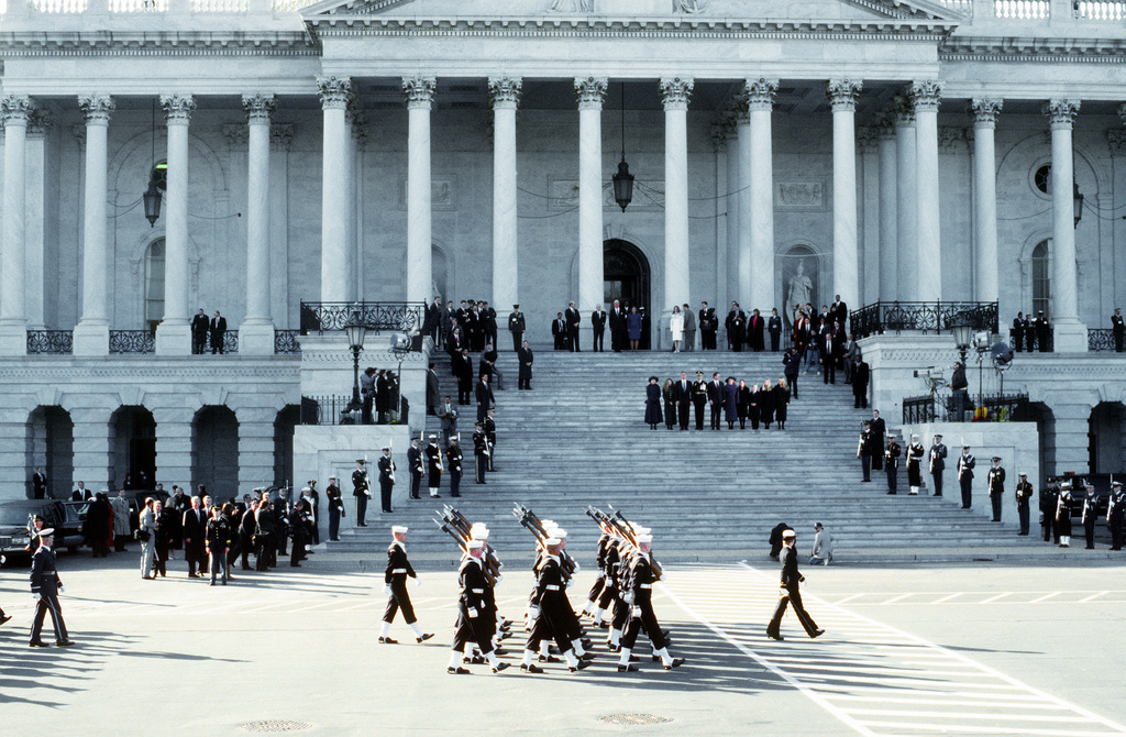 The U.S. Navy ceremonial guard marches past President Clinton and Vic President Gore at the east side of the capitol building as part of the presidential escort for the 1993 Presidential Inauguration parade