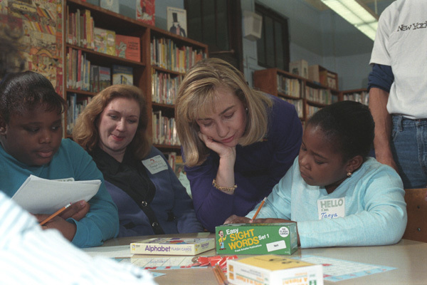 Photograph of First Lady Hillary Rodham Clinton with New York Public School Students