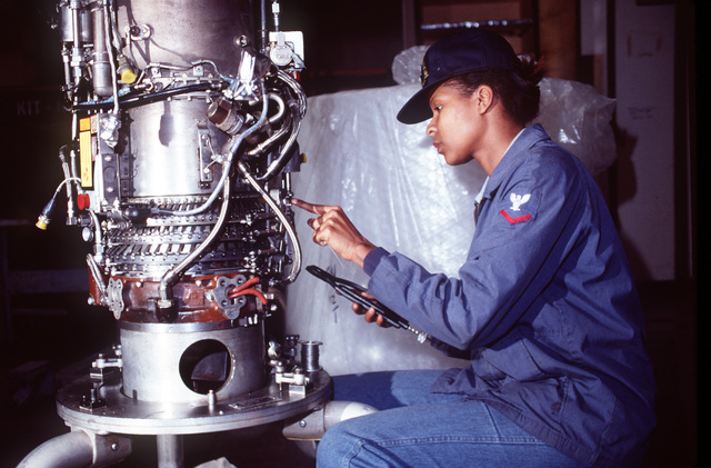 Aviation Machinist's Mate Third Class (AD3) Laura Johnson adds the last minute touches of safety wire and inspects the linkage assembly for a T-58 engine before it is shipped out to a customer. AD3 Johnson is attached to the Power Plants Division Aircraft Intermediate Maintenance Department at Naval Air Station, Sigonella