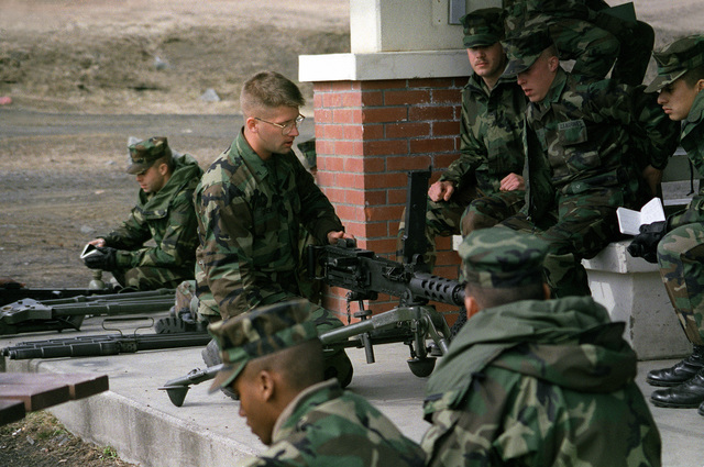 Marine Lance CPL. Drew of the training platoon gives a class on the M-2 50-caliber machine gun to Marines of Combat Service Support Detachment 36 (CSSD-36)