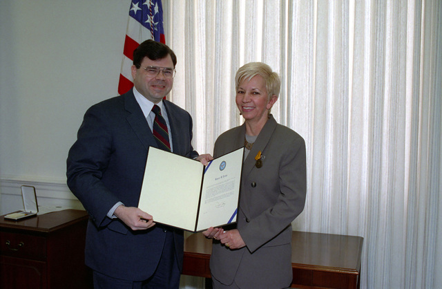 The Honorable James R. Locher, III (left), Assistant Secretary of Defense for Special Operations and Low Intensity Conflict, poses with Mrs. Janice S. Ervin (right), for an official photograph after he presented her with the Secretary of Defense Medal for Meritorious Civilian Service at an official ceremony in the Pentagon on Feb. 1, 1993.  OSD Package No. A07D-00119 (DOD PHOTO by Helene C. Stikkel) (Released)