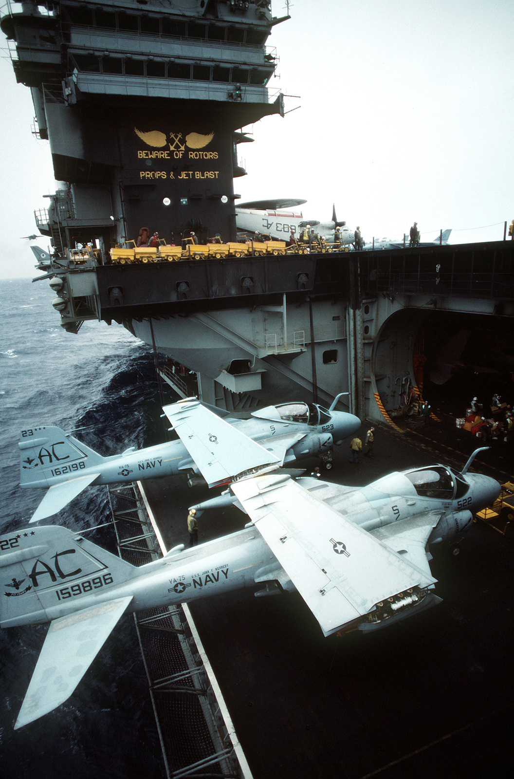 Two Attack Squadron 75 (VA-75) A-6E Intruder aircraft are secured on an elevator of the aircraft carrier USS JOHN F. KENNEDY (CV-67)