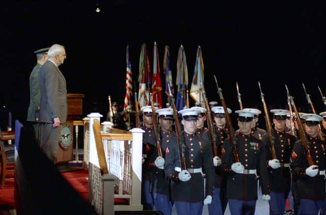 U.S. Secretary of Defense, Les Aspin (foreground left), stands at attention for the Pass In Review during his Public Oath of Office Ceremony, held at the Ceremonial Hall in Fort Myer, Va., on Feb. 1, 1993.  OSD Package No. A07D-00122 (DOD PHOTO by Robert D. Ward) (Released)